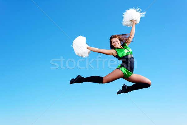 девушки прыжки фон синий небе женщину Сток-фото © adam121