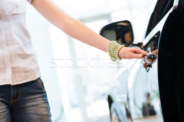 woman opens the door to a new car Stock photo © adam121