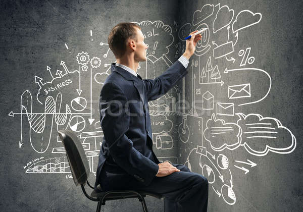 Empresario dibujo estrategia de negocios sesión silla negocios Foto stock © adam121