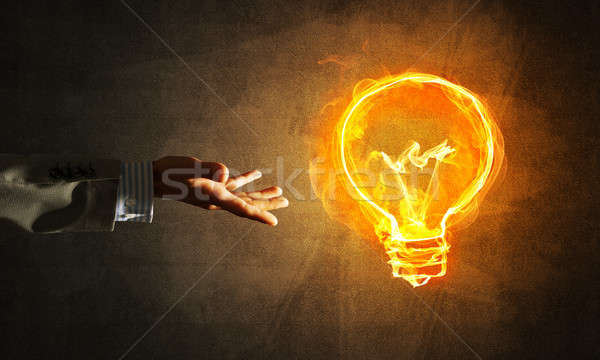 Concept of electricity or inspiration with burning light bulb Stock photo © adam121