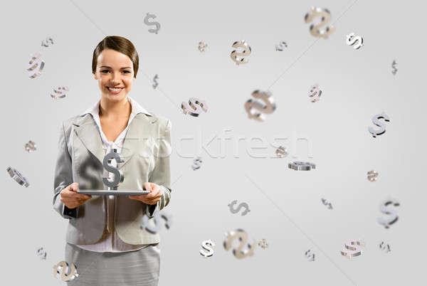 Mujer de negocios sonriendo mesa atractivo tableta Foto stock © adam121
