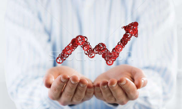 Stock photo: Progressing graph presented in male palms as symbol of success and improvement