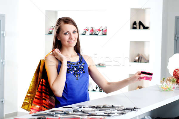 woman at shopping checkout paying credit card Stock photo © adam121