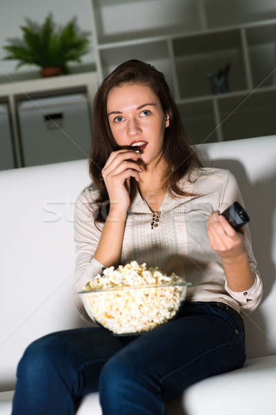 young woman watching TV Stock photo © adam121