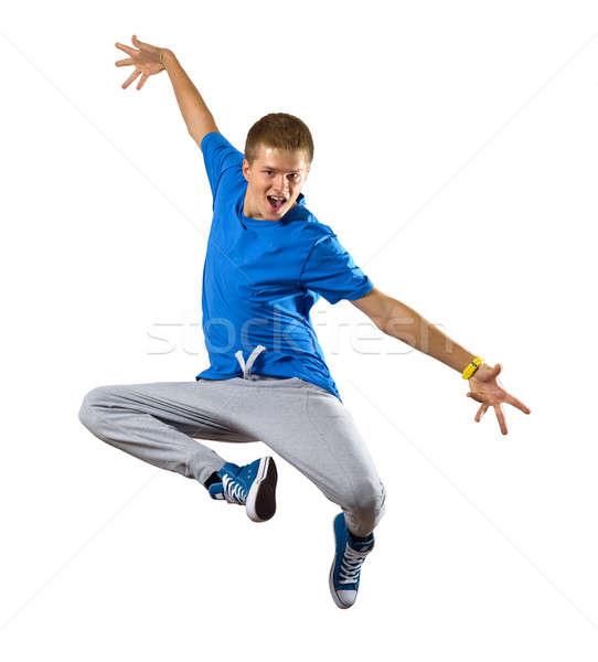 Jonge man danser springen geïsoleerd witte dans Stockfoto © adam121