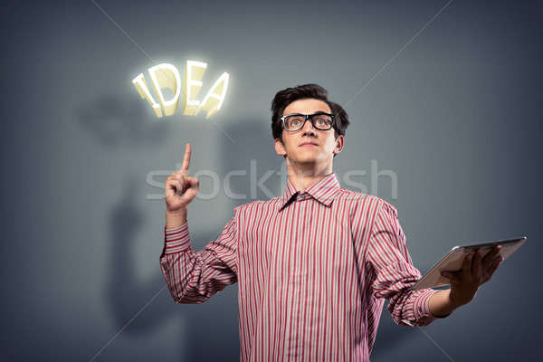 Jeune homme comprimé main up science Photo stock © adam121