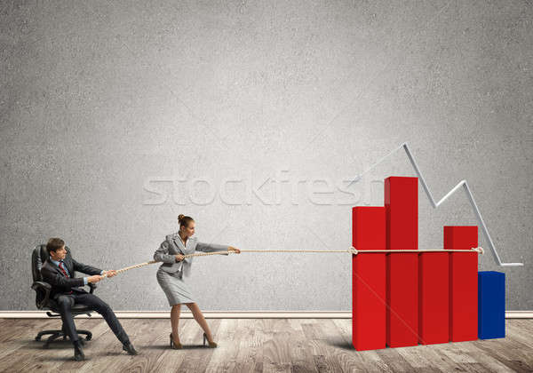 Businesspeople pulling with effort graph growth as a symbol of financial success Stock photo © adam121