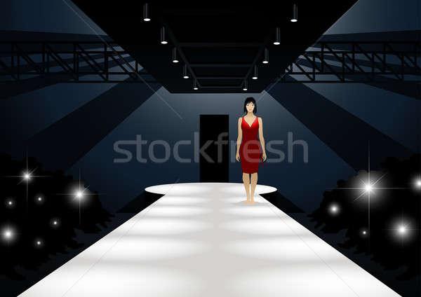 Divat modell vörös ruha sétál lefelé kifutó Stock fotó © adamfaheydesigns