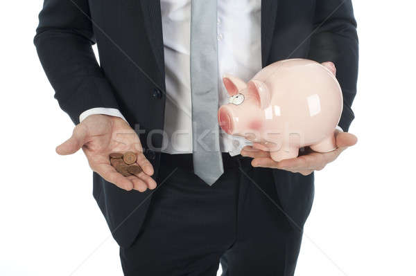 businessman with some coins and piggy-bank Stock photo © advanbrunschot