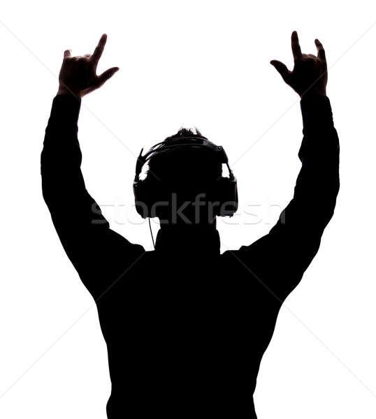 Man rocking on with headphones Stock photo © aetb