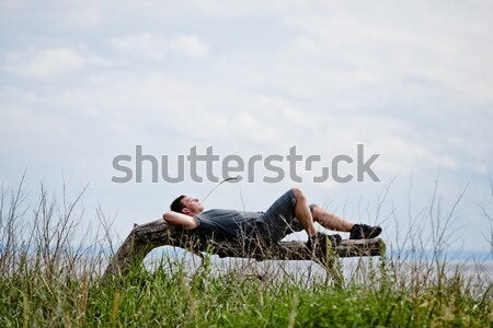 Young Adult Relaxing Peacefully in Nature Stock photo © aetb