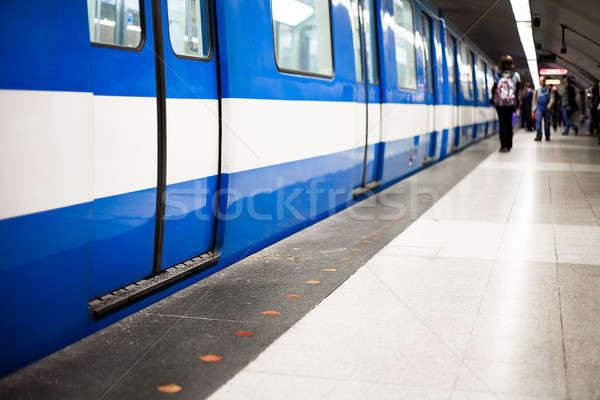 Colorful Underground Subway Train with blurry people in the back Stock photo © aetb
