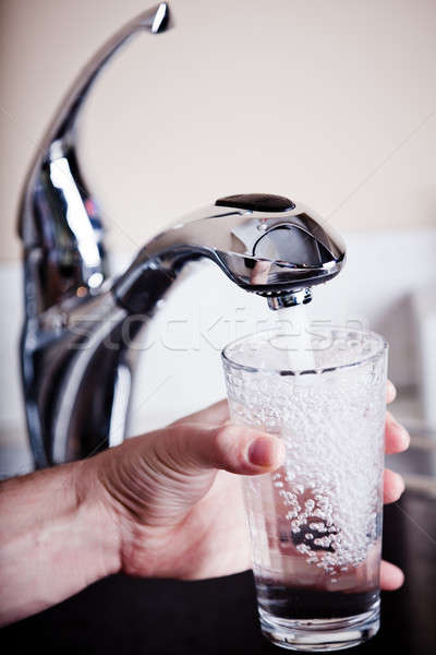 Thirsty man filling a big glass of water Stock photo © aetb