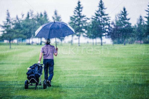 ゴルファー 雨の 日 ゴルフコース ゲーム 男 ストックフォト © aetb