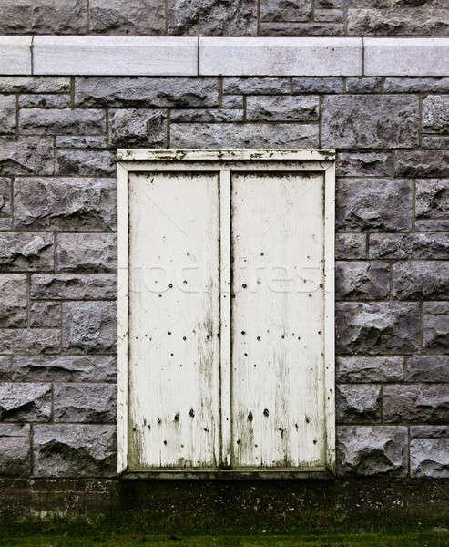Beige Door in a stone wall.  Stock photo © aetb