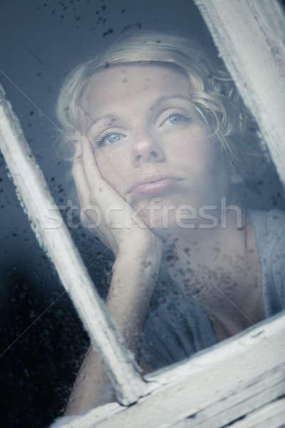 Sıkılmış kadın bakıyor yağmurlu hava durumu pencere Stok fotoğraf © aetb