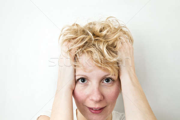 Blond Girl Pulling Hairs  Stock photo © aetb