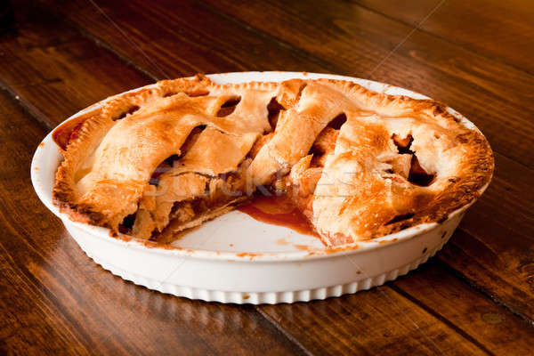 Freshly baked apple pie with a missing portion Stock photo © aetb