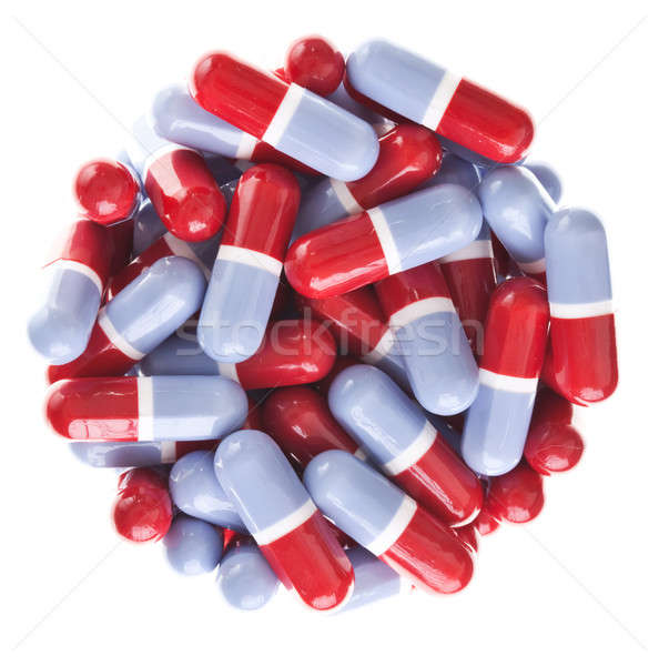 Perfect circle off Red and blue tablets Stock photo © aetb