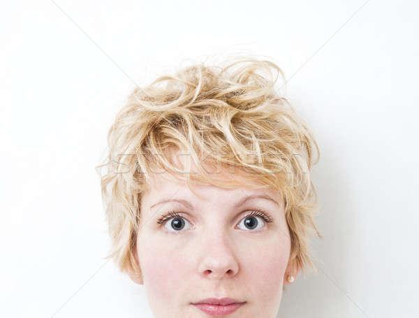 Szőke lány néz kamera rendetlen ahogy Stock fotó © aetb