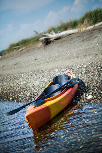 Orange and Yellow Kayak With Oars on the Sea Shore Stock photo © aetb