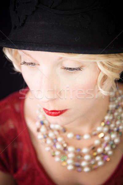 Bella signora guardando verso il basso vecchio stile stile shot Foto d'archivio © aetb