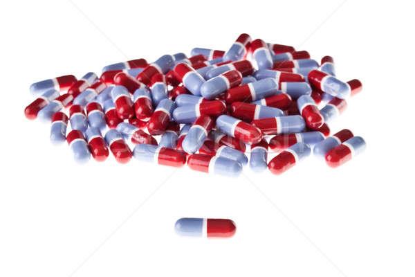 Halom piros kék tabletták izolált fehér Stock fotó © aetb
