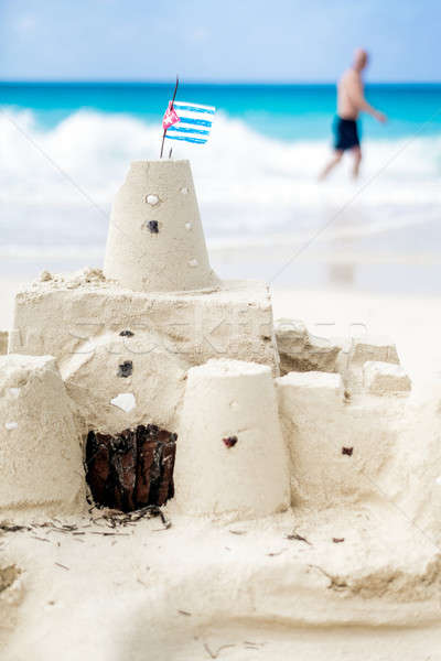 Stock photo: Cuban Sandcastle with the country Flag in Cuba.