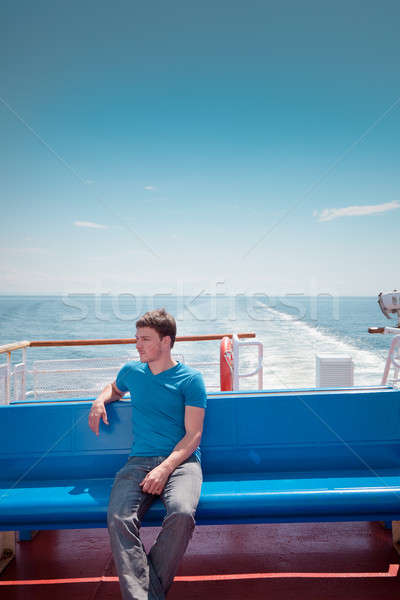 The young man on the deck against the sea Сток-фото © aetb