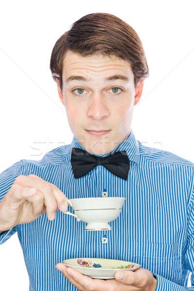 Yakışıklı beyefendi içme çay yalıtılmış Stok fotoğraf © aetb