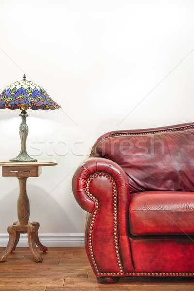 Luxurious Red Leather Couch in front of a blank wall Stock photo © aetb