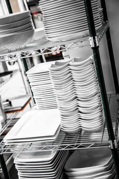 Stack of Cleaned Dishes in a Restaurant Stock photo © aetb