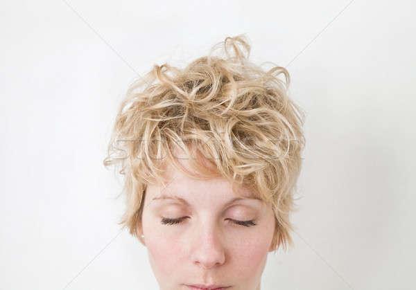 Blond dziewczyna mieszany patrząc w dół niechlujny Zdjęcia stock © aetb