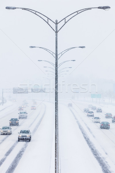 Symmetrical Photo of the Highway during a Snowstorm Stock photo © aetb