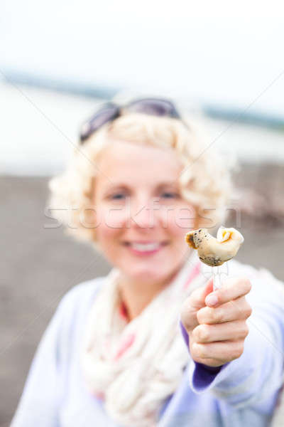 Young Woman Eating a Whelk (bourgot in french) Stock photo © aetb