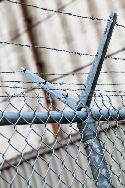 Outdoor Fence Detail of Sharp Barbwire Installation Stock photo © aetb