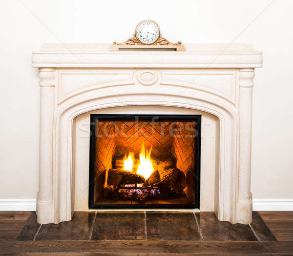 Luxurious White Marble Fireplace and empty wall Stock photo © aetb