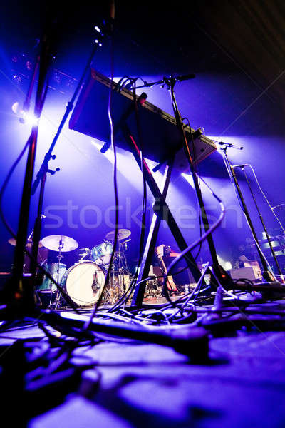 Dark image of a stage ready for a music band live performance Stock photo © aetb