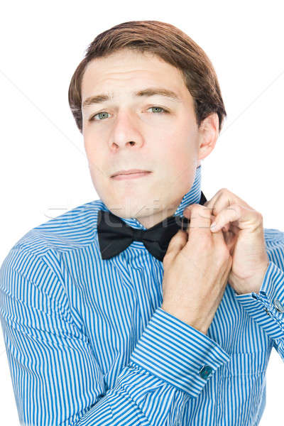 Handsome old-fashioned gentleman adjusting his bow tie  Stock photo © aetb