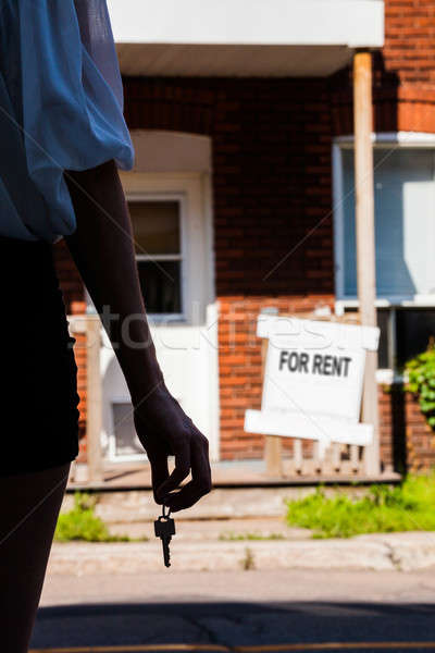 Young Woman standing in front of her new apartment Stock photo © aetb