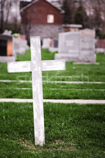 White Cross in a Old Cemetery Stock photo © aetb