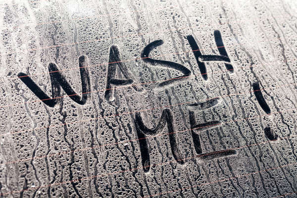 Wash Me Words on a Dirty Car Window Stock photo © aetb