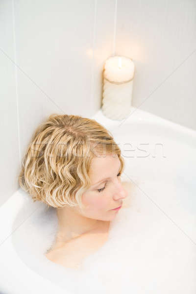 Young woman relaxing in the bath Stock photo © aetb