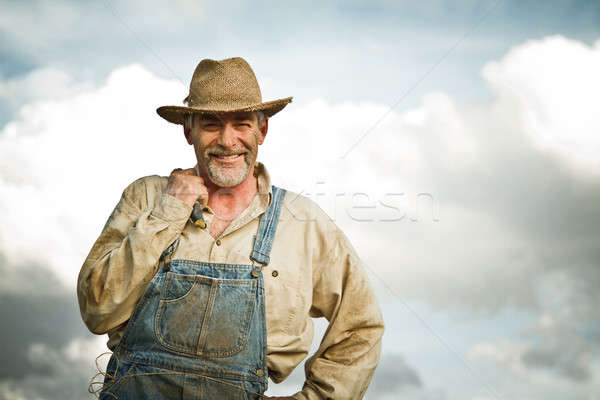 1930s farmer smiling at the Sun Stock photo © aetb