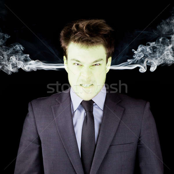 Furious businessman getting green face Stock photo © aetb