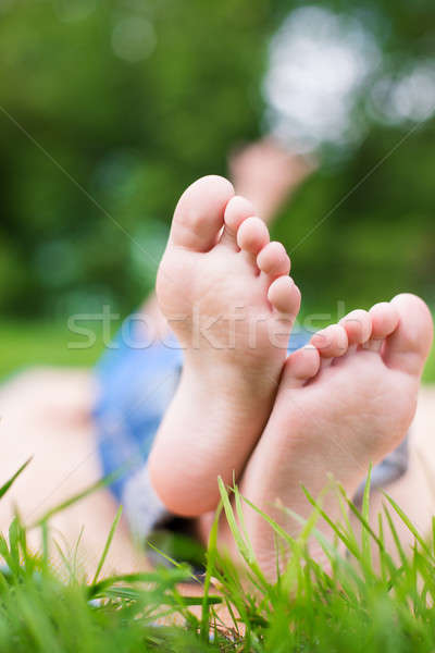 Two Child's crossed foots Stock photo © Agatalina