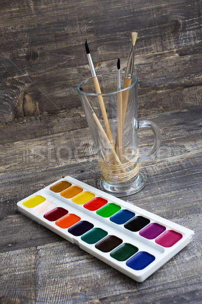 Brushes in vase and watercolor paints Stock photo © Agatalina