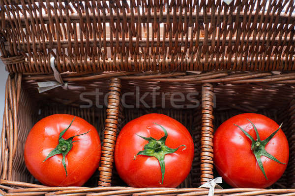 Three tomatoes with dew lying in wicker box Stock photo © Agatalina