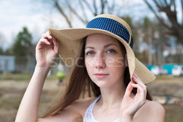 Freckled happy girl holding hat and looking at camera Stock photo © Agatalina