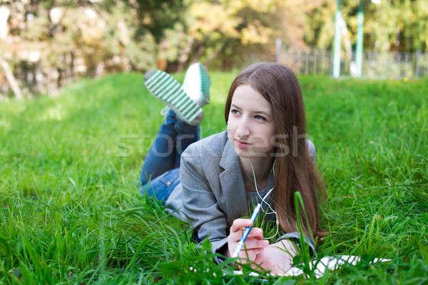 студент наушники трава книга солнце Сток-фото © Agatalina